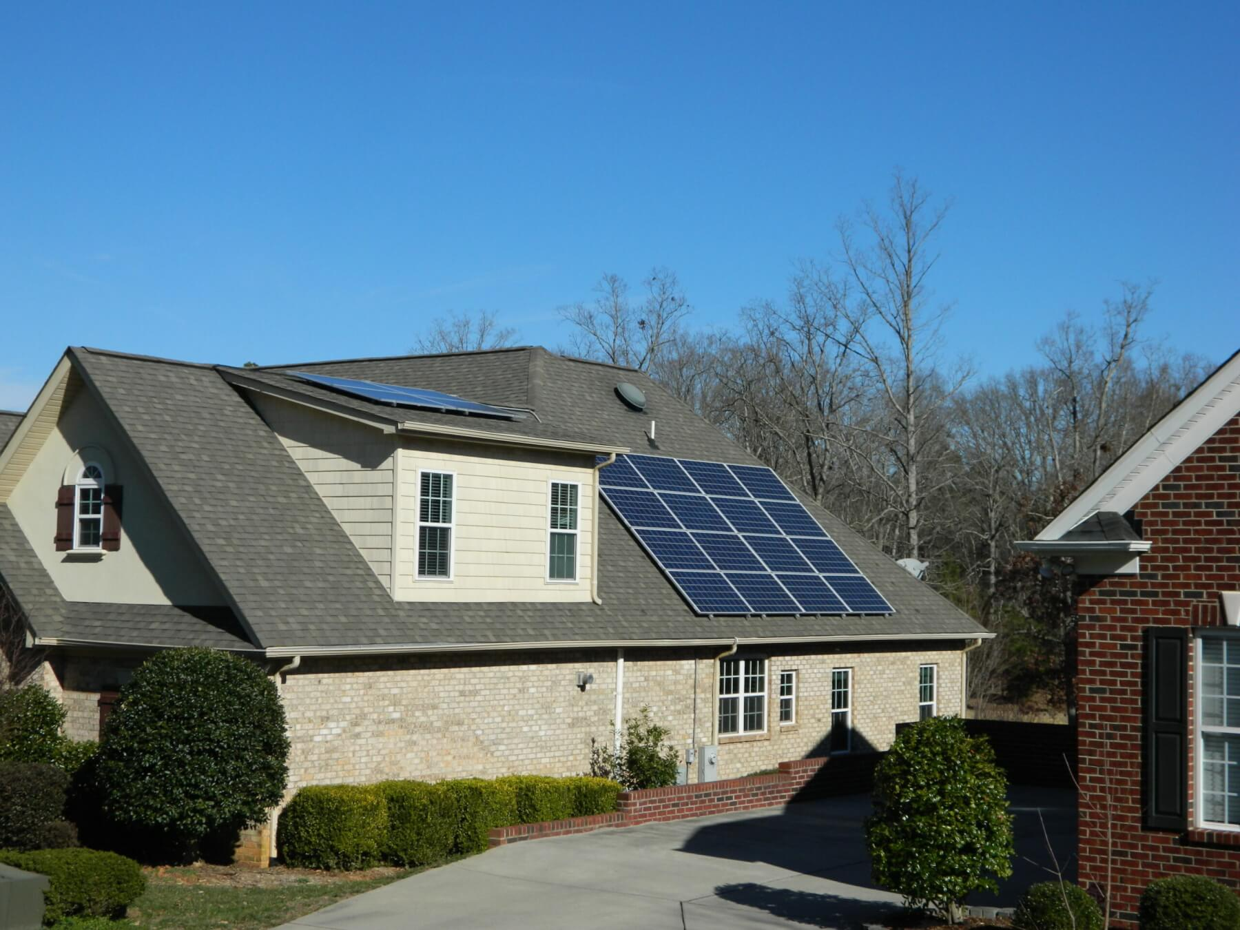 Beautiful house with solar panels installed on the roof