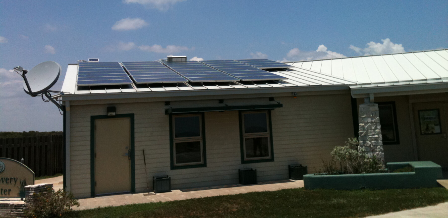 Roof with solar panels and antenna
