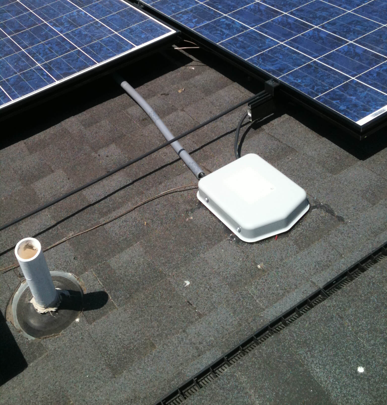 Roof with solar panels and inverter